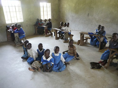 lack-of-facilities-across-schools-in-kenya-can-mean-3-or-4-children-sharing-a-desk-designed-for-2-or-even-working-from-the-floor_13289739953_o.jpg