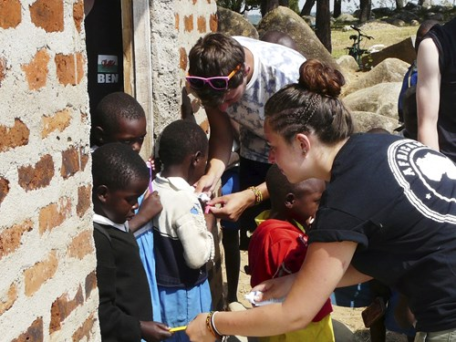 moving-mountains-africamp-volunteers-give-out-toothbrushes_13289928374_o.jpg