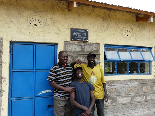 members-of-the-community-development-team-with-moving-mountains-africamp-staff-showing-off-their-new-classroom_7830764208_o.jpg
