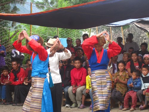 traditional-dancers-celebrate-the-opening-of-hydro-electric-project_13104703835_o.jpg